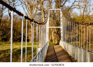 Suspension bridge and forest in autumn