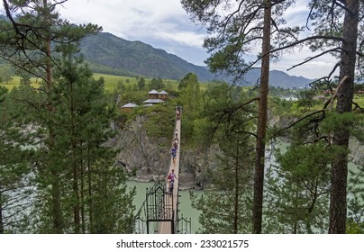 Suspension bridge to the monastery on the island of Patmos, Altai, Russia. The island got its name in honor of the Greek island of Patmos.