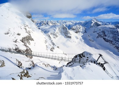 Suspension bridge on Mt. Titlis in winter and panorama mountains view, Engelberg Switzerland.