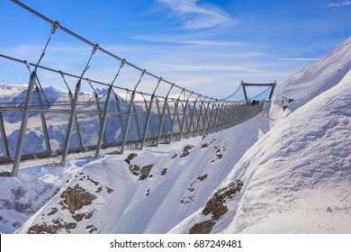 Suspension bridge on Mt. Titlis in wintertime. The Titlis is a mountain located on the border between the Swiss cantons of Obwalden and Bern, mainly accessed from the town of Engelberg.