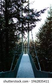 Suspension bridge on a winter day at Gorge Park, Coaticook