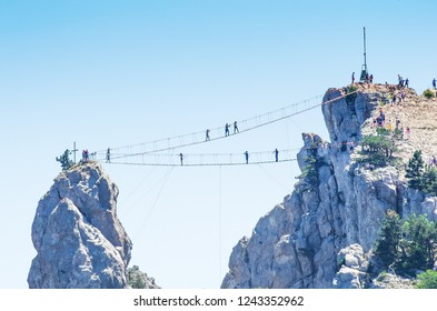 Suspension bridge over the abyss. Russia, Republic of Crimea. 06.13.2018. Suspension bridge on Mount Ai-Petri. Extreme attraction for tourists