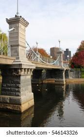 Suspension bridge over the Frog Pond in Boston Common Public Gardens taken in the autumn