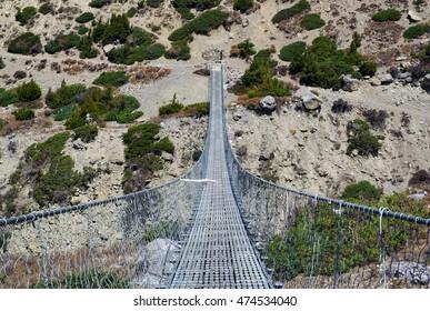 Suspension bridge over Khola Ghyanchang river