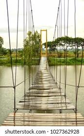 Suspension bridge over the river.