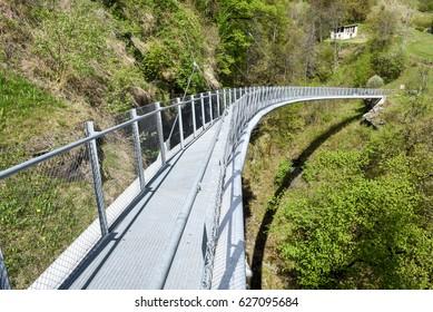 Suspension bridge over the river at Leontica on the swiss alps