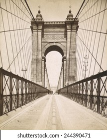 Suspension Bridge spanning the Ohio River at Cincinnati was engineered and built by John A. Roebling. Opened in 1866 it was then the World's longest bridge.