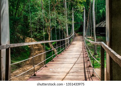A suspension bridge is a type of bridge in which the deck (the load-bearing portion) is hung below suspension cables on vertical suspenders.