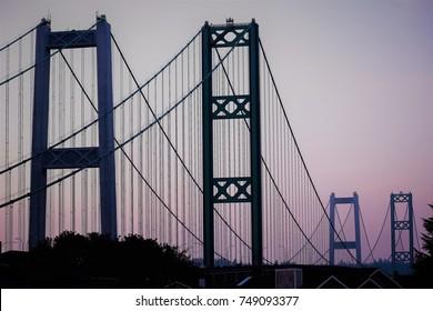 Suspension Bridge Under a Pink Sunset