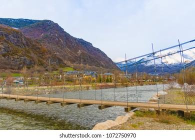 Suspension bridge within Noguera de Tor river, Barruera, Vall de Boi, Lleida, Catalonia, Spain
