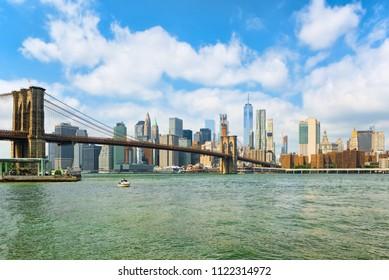 Suspension Brooklyn Bridge across the East River between the Lower Manhattan and Brooklyn. New York, USA.
