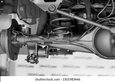 Suspension car,Suspension Pickup truck.Car service mechanic unscrewing automobile parts while working under a lifted auto.Disc brake of the vehicle for repair in process of new tire changed. Close up.