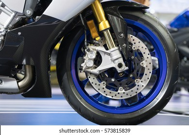 Suspension and disc brake system of modern motorcycle's front wheel.