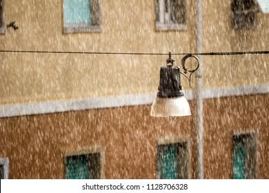suspension street lamp under rain and direct sunlight