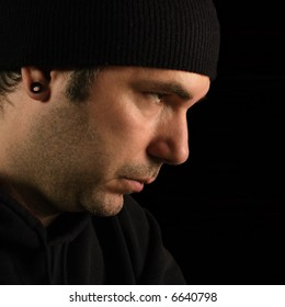 A suspicious male portrait - burglar, prowler, thief.