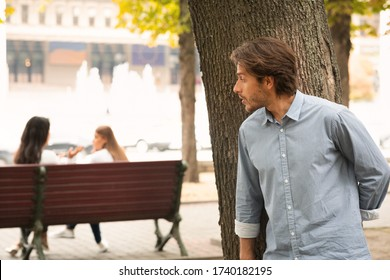 Suspicious Man Spying On Girls Stalking Them While They Talking Sitting In Park