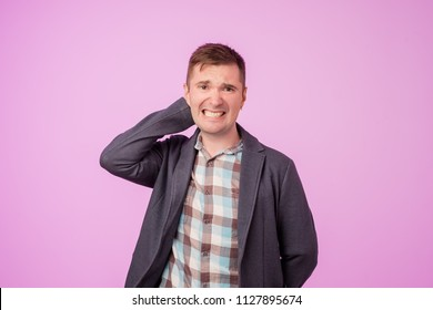 Suspicious middle aged european man looks doubtfully, being indecisive, makes grimace, tries to find solution. He is not sure in decision. Negative facial expressions concept.