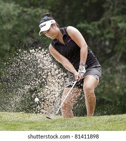 SUSSEX, CANADA - JULY 21: Anna (Younjin) Kim of Chandler, Arizona/Toronto, Ontario, explodes out of the sand at the CN Future Links Atlantic Championship on July 21, 2011 in Sussex, Canada.