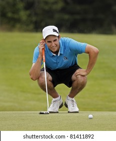 SUSSEX, CANADA - JULY 21: Chad MacMillan of Kingston, NS, studies his putt at the CN Future Links Atlantic Championship on July 21, 2011 in Sussex, Canada.