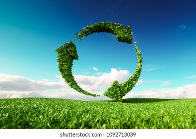 Sustainable development, eco friendly lifestyle concept. 3d rendering of arrow circle icon on fresh spring meadow with blue sky in background.