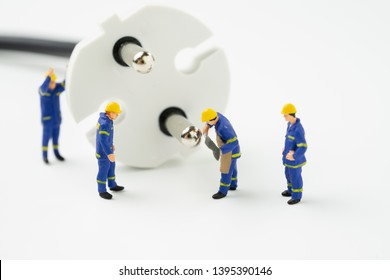 Sustainable energy, power consumption or electricity innovation concept, miniature people worker, technician help fixing or building electricity plug on white background with copy space.