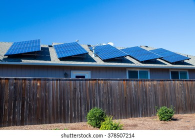 Sustainable energy from the sun goes into these solar panels on top of a house in Oregon.
