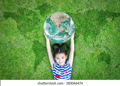 Sustainable environment, world ecosystem, csr with people, ecological friendly and go green concept with happy girl kid raising earth globe on lawn planet map. Element of image furnished by NASA