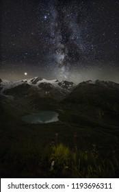 Sustenpass by night with milky way galaxy. star sky, Swiss Alps