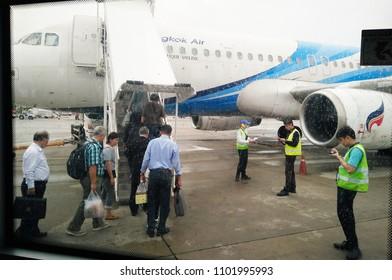 SUTHEP, MUEANG CHIANG MAI, CHIANG MAI, THAILAND, MAY 28, 2018: The Bangkok Airways passengers are boarding pass on aircraft land side at Chiang Mai International Airport, Thailand.