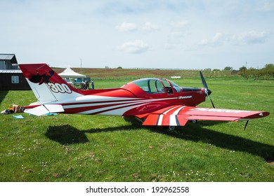 SUTRI, LAZIO, ITALY - APRIL 6, 2014: Red Pioneer 300 Hawk  ultralight aircraft at La Valicella airfield. The Pioneer 300 Hawk is an Italian ultralight and light-sport aircraft.