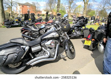 SUTTON IN ASHFIELD, NOTTINGHAMSHIRE, UK. APRIL 11, 2014.  A group of Hells Angel motorcycles parked at the funeral of a chapter president.