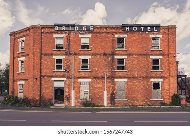 Sutton Bridge, Lincolnshire, England, UK - April 26, 2019: The derelict remains of the Bridge Hotel