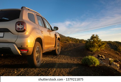 SUV driving on mountain off-roads