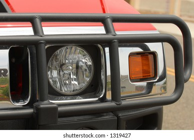 SUV headlight with grill guard
