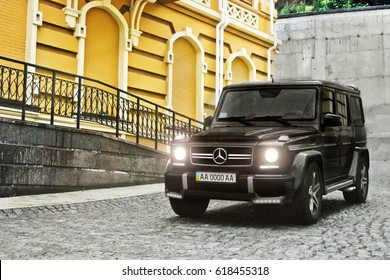 SUV with lights on. Kiev - Ukraine; April 21, 2015. Editorial photo. Mercedes-Benz G63 AMG in the old town. Powerful SUV.