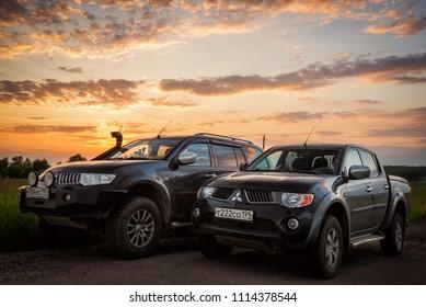 SUV Mitsubishi L200 and Pajero Sport,  Moskow, Russia. 06-02-2016
