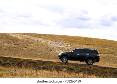 SUV on the hill