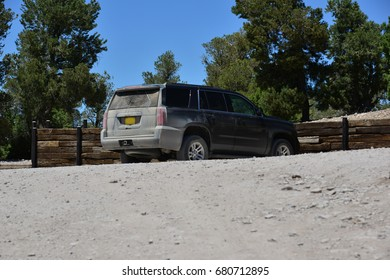 An SUV parked at the top of Garnet Hill at Ely, Nevada at the height of summer.