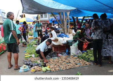 Suva, Fiji - June 5 2015: People buying and selling vegetables during the weekend market in Suva, Fiji.