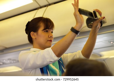 SUVARNABHUMI INTERNATIONAL AIRPORT, BANGPLI, SAMUTPRAKARN, OCTOBER 03, 2017: The flight attendant of Bangkok Airways is showing inflight safety demonstration on flight number PG 215.