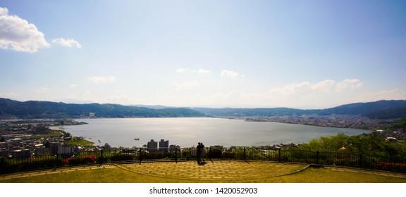 Suwa, NAGANO / JAPAN - May 15 2017: Lake Suwa in Nagano atop a vantage point. Famously used in the japanese animation 'Kimi no na wa'.