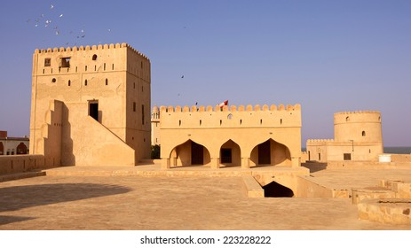 AS SUWAYQ, OMAN - JANUARY 10, 2009: Pigeons fly over a tower at the castle in the market town of As Suwayq, in the Sultanate of Oman.