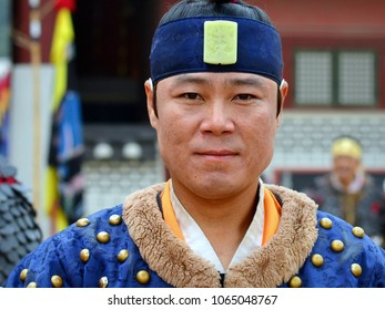 SUWON, SOUTH KOREA - JUNE 1, 2013: Young Korean martial arts performer wears traditional military attire and poses for the camera at Hwaseong Haenggung Palace near Seoul, on June 1, 2013.