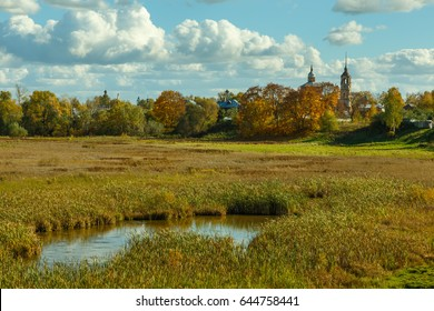 Suzdal, Golden ring of Russia. Autumn landscape with church and pond.