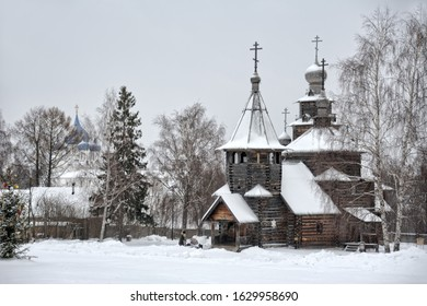 SUZDAL, RUSSIA - Architectural ensemble of 18th century wooden churches framed by trees on the grounds of the museum of Wooden Architecture covered snow in winter season.