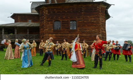 Suzdal, Russia - August 14, 2016: International Quilt Festival in Suzdal 'Soul of Russia'. Reconstruction of the traditional Russian wedding. Wedding dances next to the wooden church.