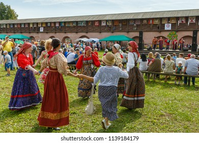 Suzdal, Russia - August 19, 2016: Folk festivities dedicated to the Harvest Festival. Women dance in traditional Russian dresses.
