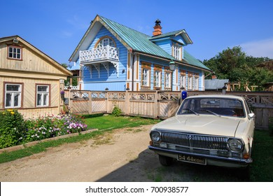 SUZDAL, RUSSIA - AUGUST 19, 2017. Wooden house with Soviet Volga car in front of him. Lebedeva street, Suzdal, Russia.