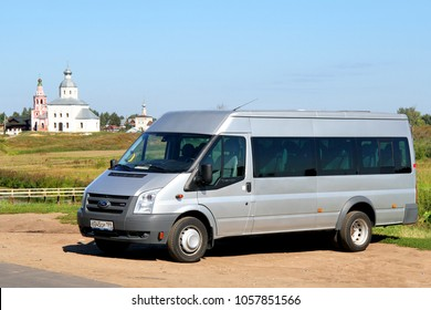 Suzdal, Russia - August 23, 2011: Grey passenger van Ford Transit in the city street.