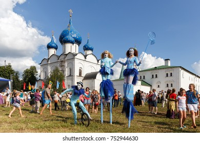 Suzdal, Russia - August 9, 2014: Day of the city. Clowns mimes entertain people on the territory of Suzdal Kremlin.